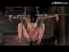 Girl Tied To Pole Mouthgag Nipple Clips Getting Her Pussy Fingered Stimulated With Vibrator Whipped Lifted Fucked With Dildo In The Dungeon