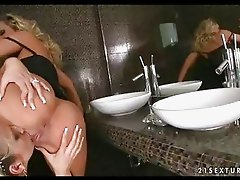 Blonde whores Bambi and Vega Vixen both getting horny hot in the washroom