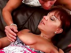 Mature redhead Nika works a cock
