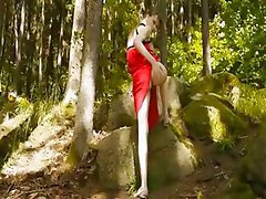 Glass dildo in her girly cunt in forest
