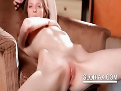 Slim Gloria shows peachy twat in close-up