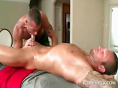 Oily attractive guy gets dick blown by gay masseur