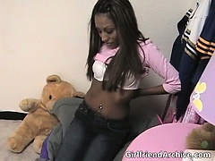 Nasty ebony bitch gets naked for the cam