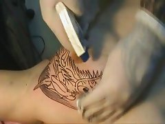 Tattooing Dragon Head on Tit !!!