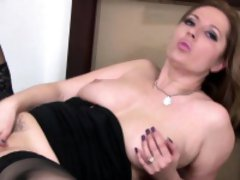 Brunette MILF masturbating on the pouffe