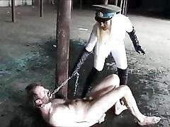 Femdom mistress steps on her BDSM slaves face and teases