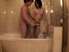 Adorable Oriental teen gets her wet pussy toyed and fucked