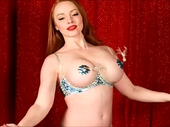 Provoking redhead puts her amazing big hooters on display