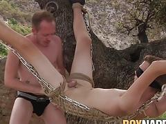 Assfucked sub twink hanging from a tree