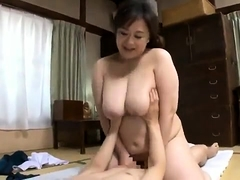 Big breasted Oriental wife takes a hard shaft for a hot ride