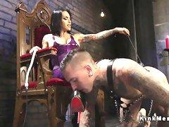 Tattooed male slave worships trannys feet