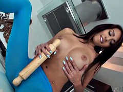 janice griffith rubs a rolling pin on the kitchen counter