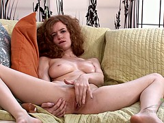She oils her slim body before toying her ginger twat