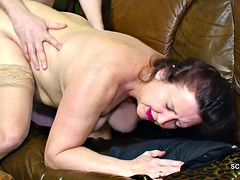 The young german boy's stepmother seduced him to fuck for the first time,