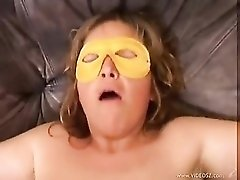 Chubby milf in a mask fucked in hole