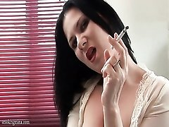 Sexy sheer blouse on hot milf smoking cigarette
