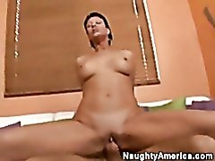 Milf with shaved pussy sitting on a stiff dick