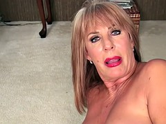 Busty blonde granny fingers her wet pussy on the floor