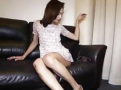 Amateur Asian ladyboy plays with her stiff shaft