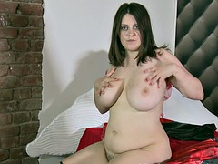 Kate gets naked and fingers her hairy pussy