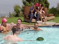 Swingers having fun in swimming pool