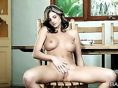 Leggy babe with beautiful big tits fingers her hot cunt