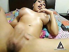Latina webcam girl rubs oil all over her body
