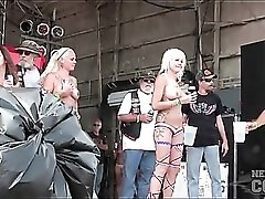 Topless girls dance for biker dudes on stage