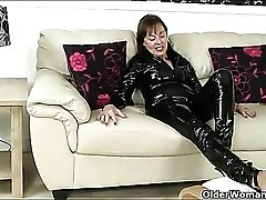 Confident granny looks hot in a latex catsuit