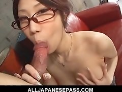 Japanese cougar Fuuka Takanashi in glasses sucking cock