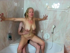 Buxom blonde milf sucks and fucks a young cock in the shower