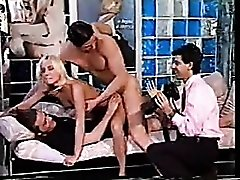 Two guys take her on and ensure her pleasure