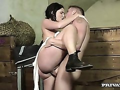 Babe in riding pants fucking on farm equipment