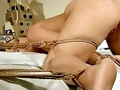 Handsome bondage babes suck dick and get pussy pumped BDSM
