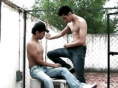 Kissing Latin twinks in an alley outdoors